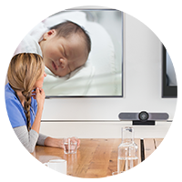 woman looking at baby in widescreen monitor