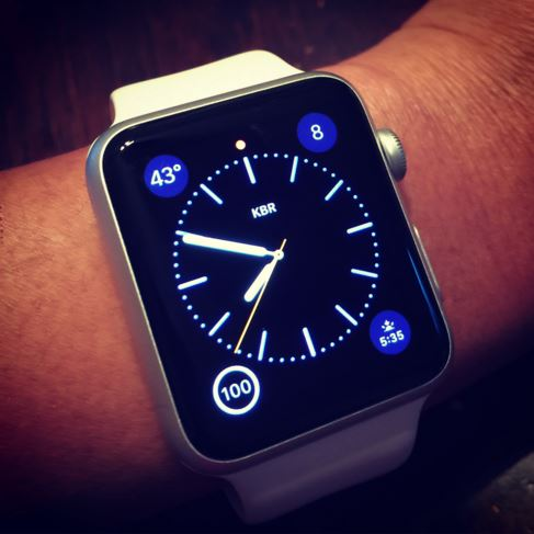 iWatch displaying time on male wrist