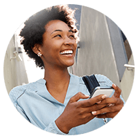 Smiling businesswoman using smart phone