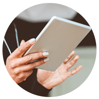 Close up of woman holding tablet device