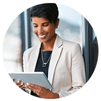 Smiling businesswoman holding tablet device outside