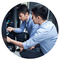 Two IT professionals working in server room
