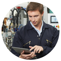 Industry professional using tablet on manufacturing floor