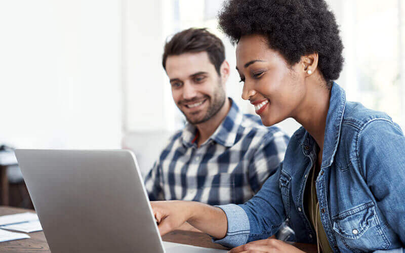 Man and woman use an insight.com account on laptop