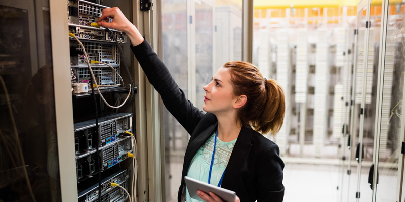 Business woman in server room