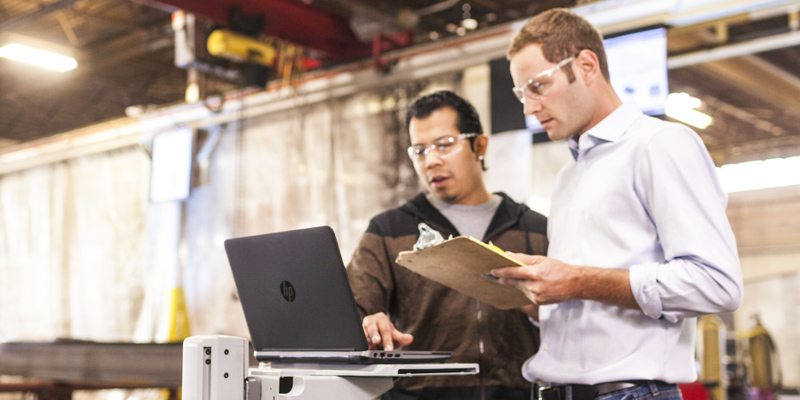 Men working in manufacturing plant with the HP ProBook 440