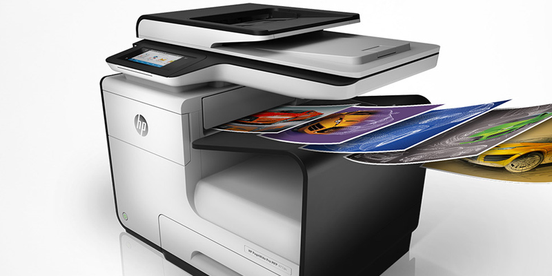 HP PageWide Pro 477dw MFP printing out colorful documents