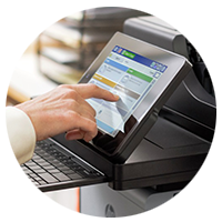 HP woman using touch screen of Officejet Enterprise Color Flow MFP X585 in office