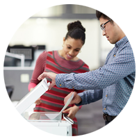 Business professionals using a HP Laserjet Pro MFP M277n.
