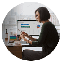 Microsoft Dynamics woman using multiple devices