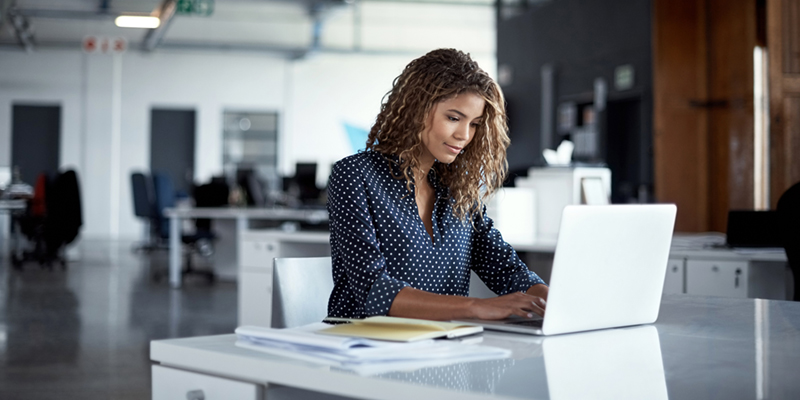 Professional business woman working on laptop computer