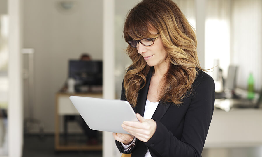 Businesswoman uses tablet device