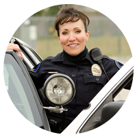 Police woman standing next to police car with door open