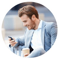 Businessman in suit on cell phone outside