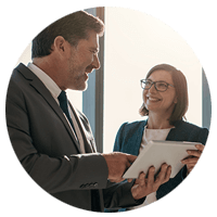 Executive on tablet computer with client