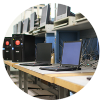 Notebook computers being tested and configured in integration lab
