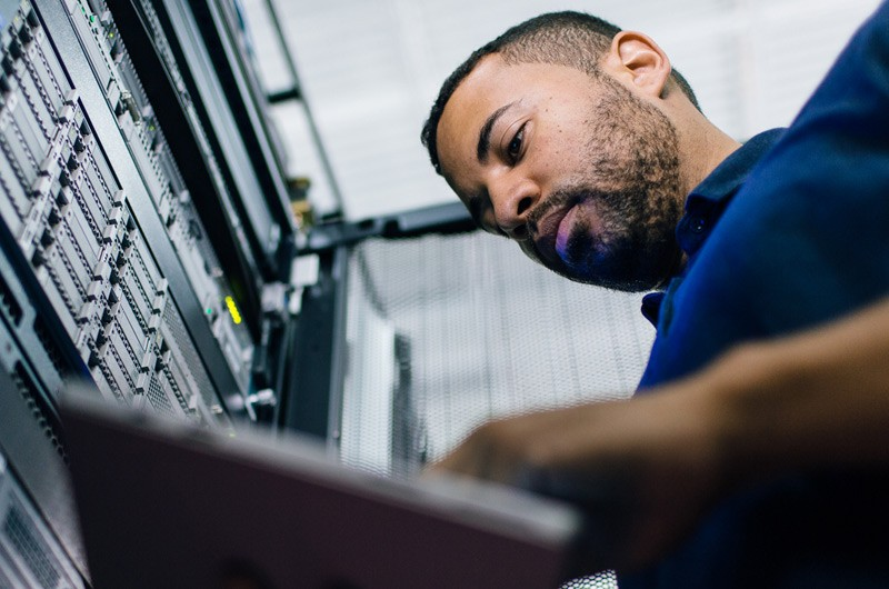 IT executive working in data center solving problem