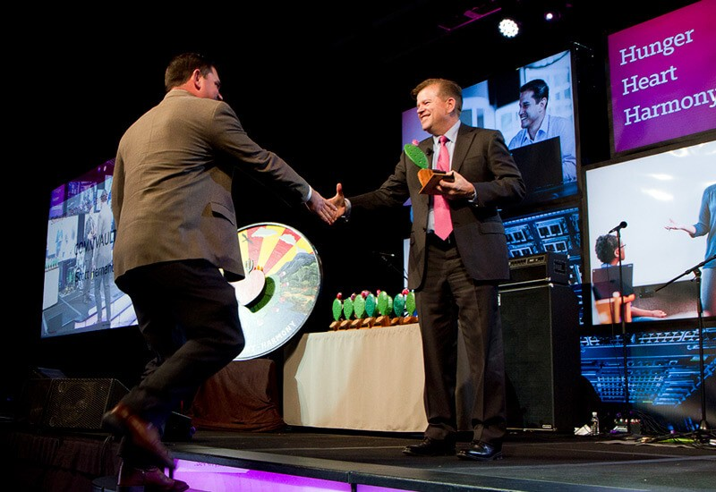 Sales team member shakes hand with SVP Bob Kane