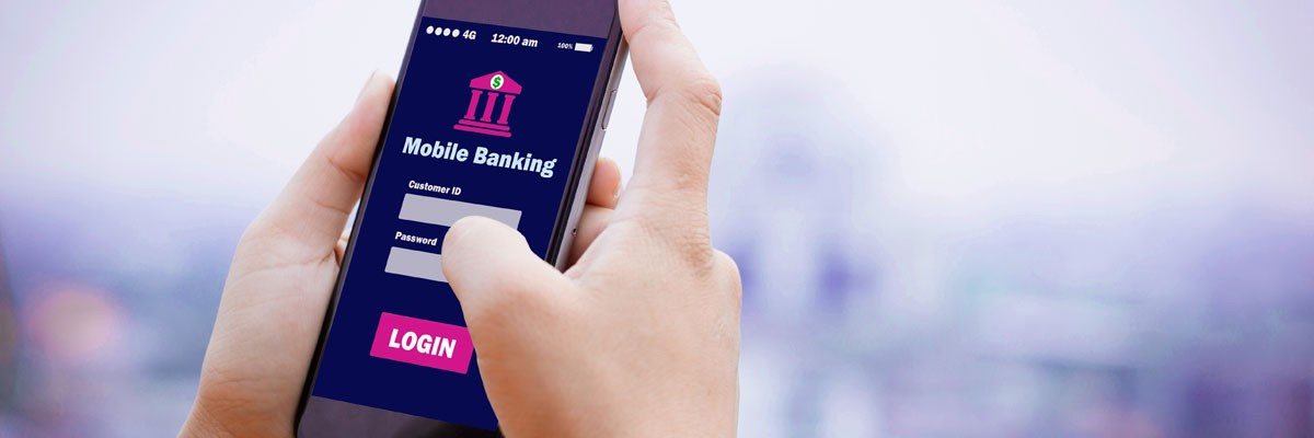 Close up of hands using a mobile banking app