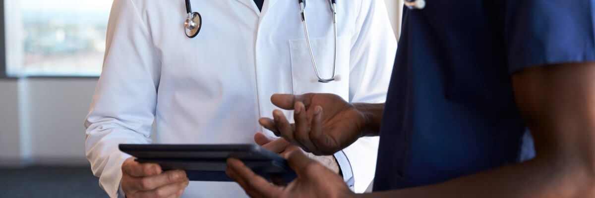 Healthcare professionals using tablet