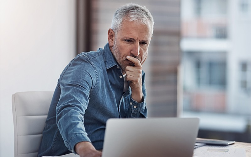 Mature businessman manager working on laptop computer
