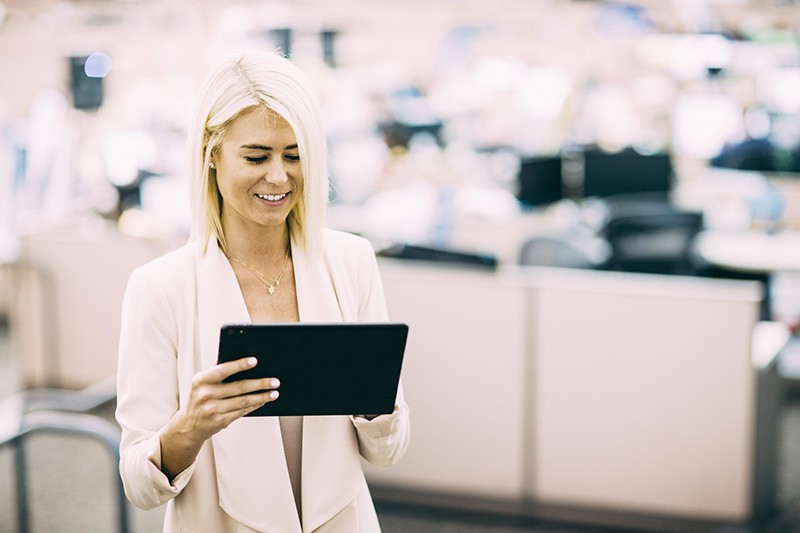 Business woman using tablet computer