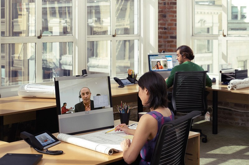Business professionals in modern office highrise with large windows.