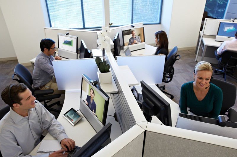 Office cubicles with workers working on their computers.