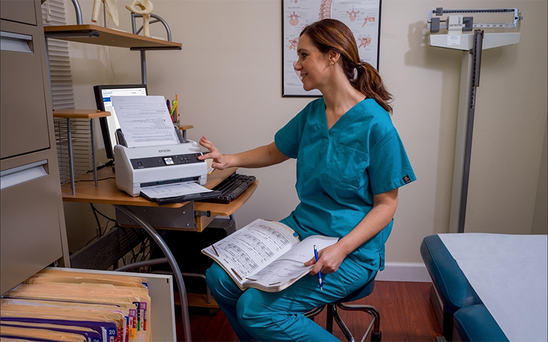 Healthcare woman printing using Epson printer