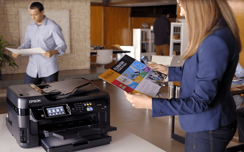 Woman working at Epson printer in open office