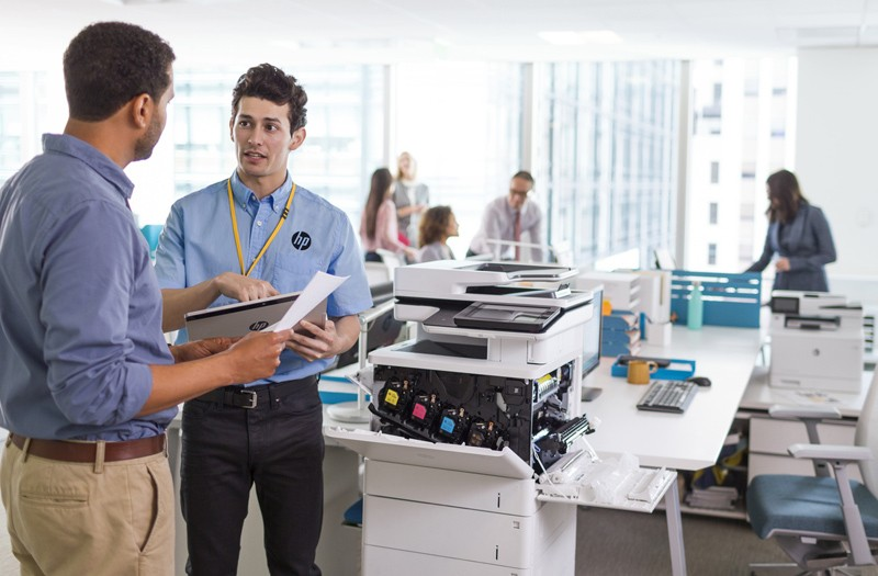 Printer technician checking the HP Color LaserJet Enterprise Flow MFP M577z