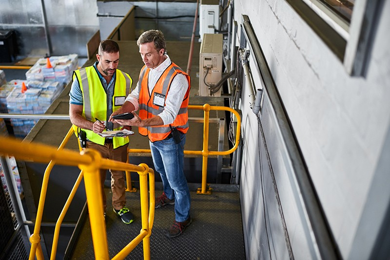 Warehouse managers track clients product from tablet computer