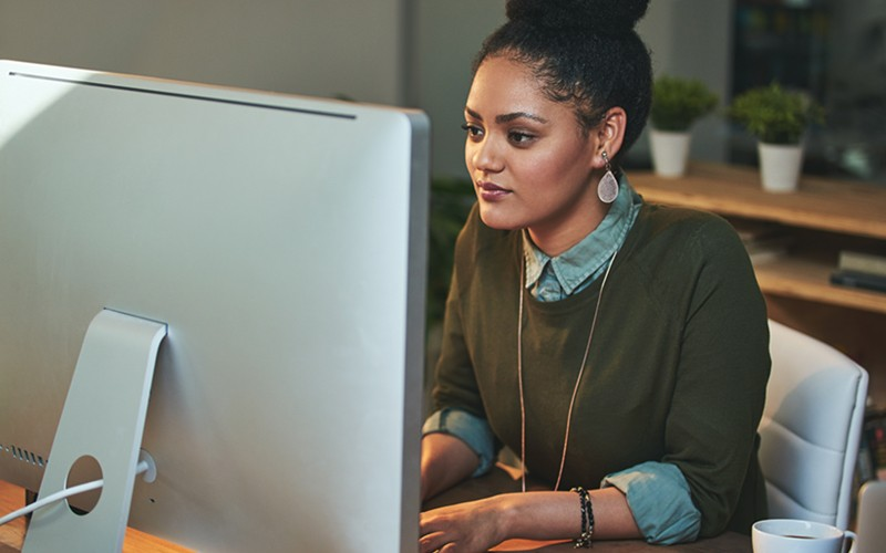 Businesswoman on desktop computer