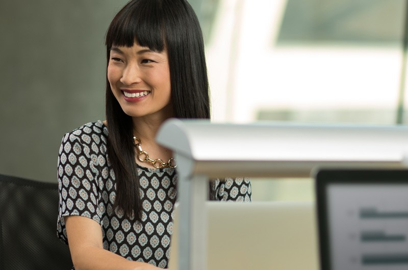 Attractive businesswoman smiling at her desk.