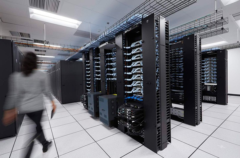 Woman Walking in a Large Data Center