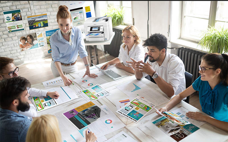 Male creative designer printing marketing material at Epson printer