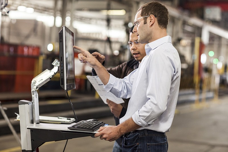 "Workers using the HP EliteOne 800 23"" AIO in manufacturing facility"