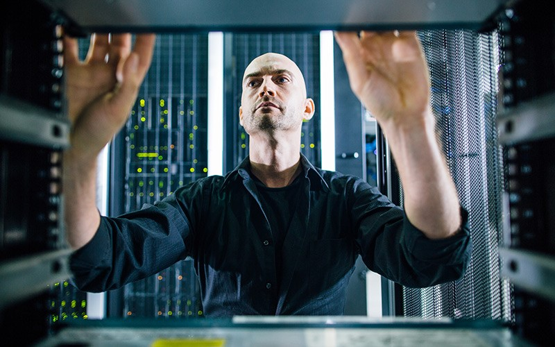 IT technician working on server racks found in data center