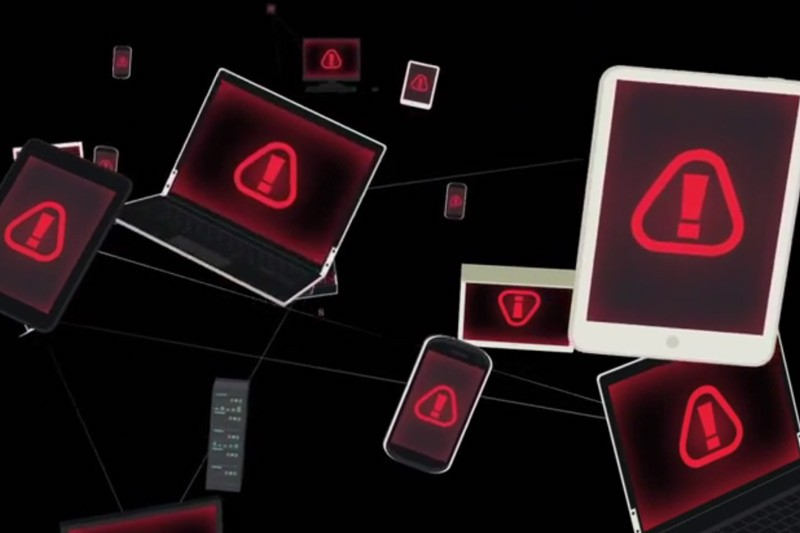 Abstract image of connected devices with warning symbols on the screen.