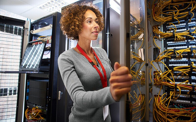 IT technician reviews server logistics in data center