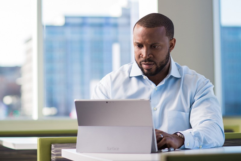 Business professional using Surface tablet computer in office