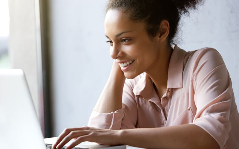 Smiling woman uses an insight.com account to purchase hardware and software